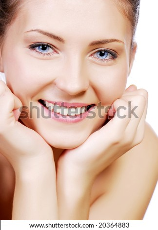 stock photo : Beautiful smiling young adult teen face with hand at face