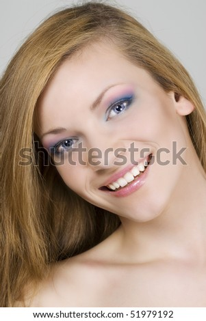 Beautiful smiling young woman face.