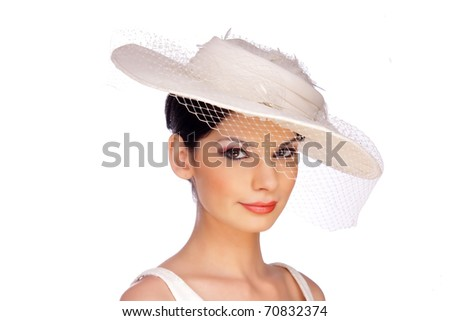 Beautiful smiling young woman in white hat with net veil. Portrait, isolated on white background,.