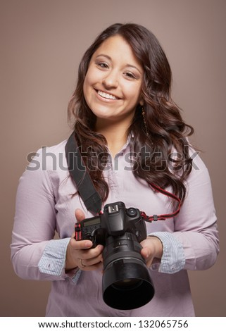 Beautiful smiling young woman photographer with camera
