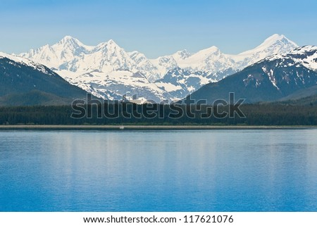 Beautiful snow capped Alaskan  mountain range along the Inside Passage