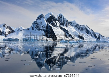Beautiful snow-capped mountains against the blue sky in Antarctica #67393744