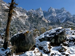 beautiful snow covered rocks and mountains at Kasol Uttrakhand a tourist hill station in India. snow gathering on rocks