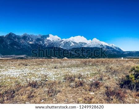 Beautiful snow mountain scenery under the blue sky #1249928620
