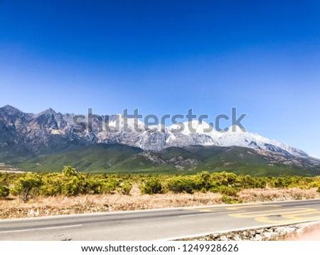 Beautiful snow mountain scenery under the blue sky #1249928626
