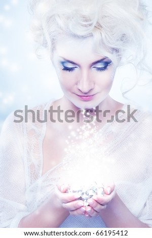 Beautiful snow queen with a christmas decoration