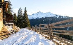 Beautiful snowed road down hill. Davos Switzerland.