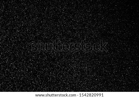 Photo of  Beautiful snowfall isolated on the black background. Seamless loop animation. Use the composite mode Screen, Add or Lighten for transparency.