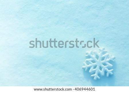 Beautiful snowflake on natural snowdrift, close up #406944601