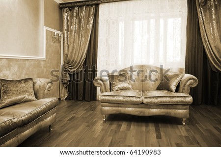 Beautiful sofa at a window in a modern apartment