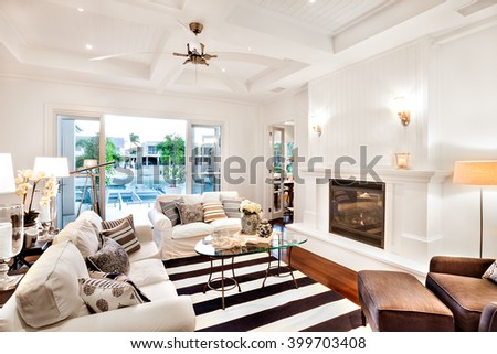 Beautiful sofa set with a glass table in the center and a telescope at the window in a luxury house