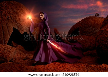 Stock Photo Beautiful sorceress with magical sword in chocolate mountains