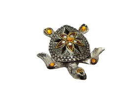 Beautiful souvenir Turtle with stones . On an isolated white background
