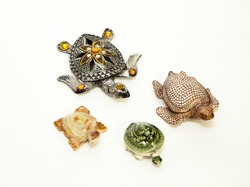 Beautiful souvenir Turtle with stones . The concept of four turtles.  On an isolated white background