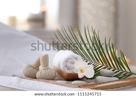 Beautiful spa composition on massage table in wellness center #1115245715