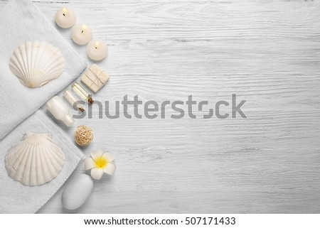 Beautiful spa composition on white wooden background #507171433