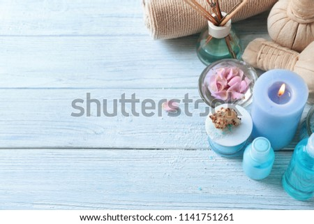 Beautiful spa composition on wooden background #1141751261