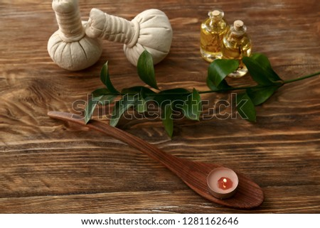 Beautiful spa composition with burning candle on wooden background #1281162646