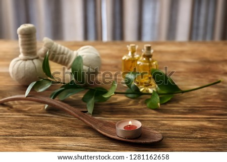 Beautiful spa composition with burning candle on wooden background #1281162658