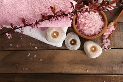 Beautiful spa composition with spring flowers on table close up