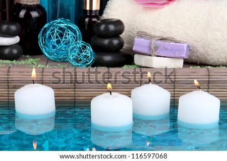Beautiful spa setting near pool on bamboo background - stock photo