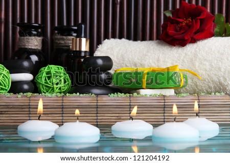Beautiful spa setting near pool on bamboo background