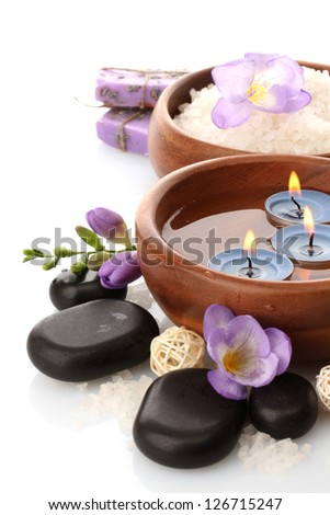 Beautiful spa setting with flowers, isolated on white