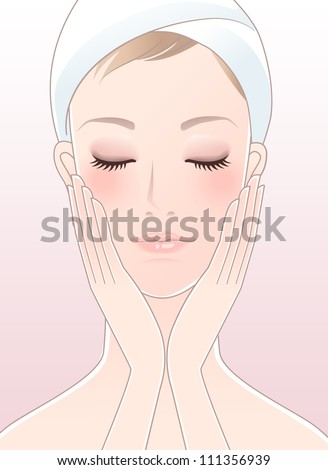 Beautiful spa woman with wrapped towel on the head, closing her eyes, touching her cheeks after Skincare.