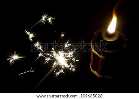 beautiful sparkler firework beside oil lamp