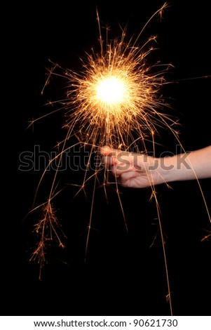beautiful sparkler in hand on black background