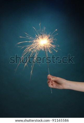 beautiful sparkler on blue background