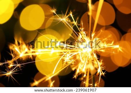 Beautiful sparkler on shiny background, close up #239061907