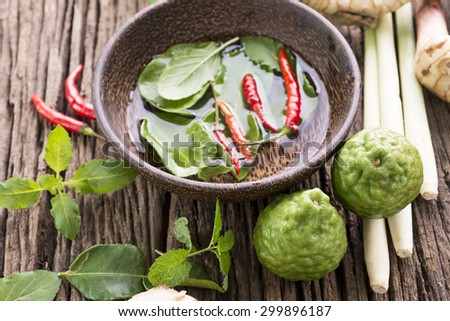 Beautiful spices and herbs on an old dark wooden board