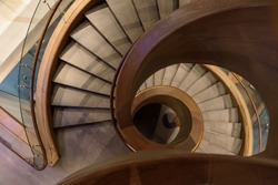 Beautiful spiral staircase made from wood and granite tiles.