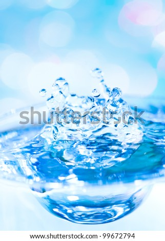 beautiful splash of water blue drops with blue lights in the background
