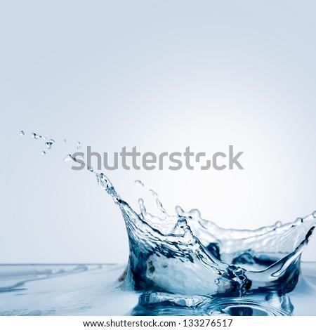 Beautiful Splash Of Water Falling From A Slice Of Lemon