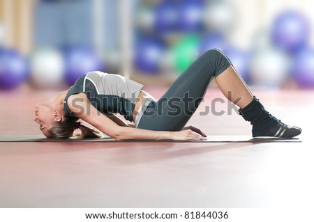 Beautiful sport woman doing stretching fitness exercise at sport gym. Yoga