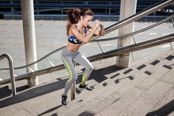 Beautiful sporty caucasian woman jumping on stairs, healthy lifestyle concept.