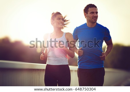 Beautiful sporty couple running and jogging