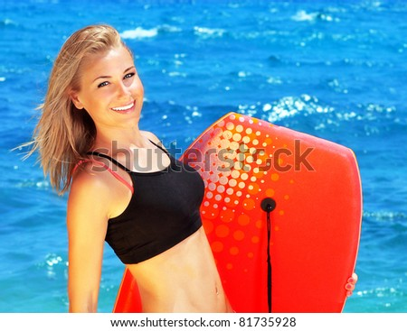 Beautiful sporty female holding body board, outdoor beach portrait, water sport, healthy lifestyle concept