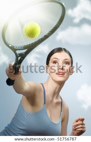 Beautiful sporty girl playing tennis very passionately