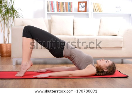 beautiful sporty woman doing exercise on the floor - stock photo