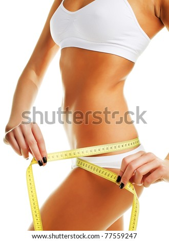 Beautiful sporty woman with yellow measure around body on white background