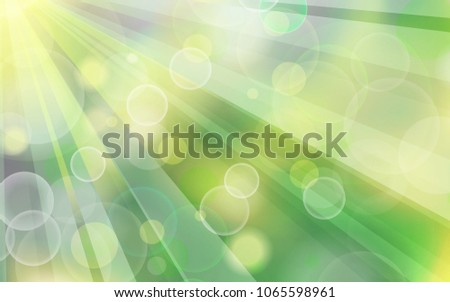 Beautiful spring abstract green natural light background with sunny rays
