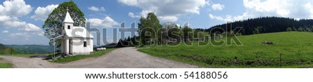 Beautiful spring and nature panorama with the chapel