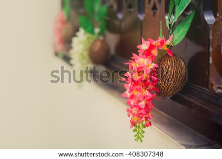 Beautiful spring bouquet of orchids on the dried Pong pong seeds (commonly known as Othalanga, Suicide tree, Buddha palm plant and Cerbera odollam). #408307348