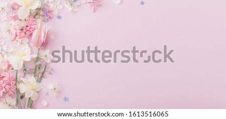 Photo of beautiful spring flowers on paper background