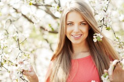 Beautiful spring girl in blooming tree