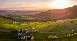 Beautiful spring landscape in Slovakia. Polana region, Hrinova, Europe. Fields and meadows with blooming cherries.