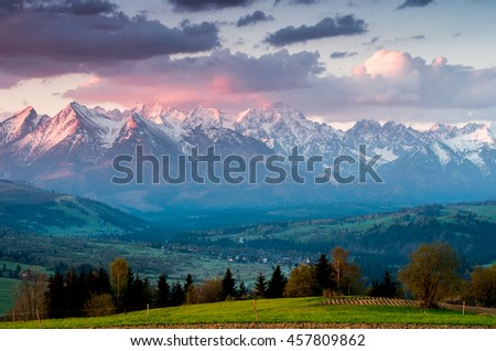 Beautiful spring panorama over Spisz highland to snowy Tatra mountains in the colorful morning, Poland #457809862